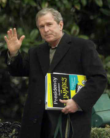 Bush with his presidential manuel 'Presidency for Dummies'